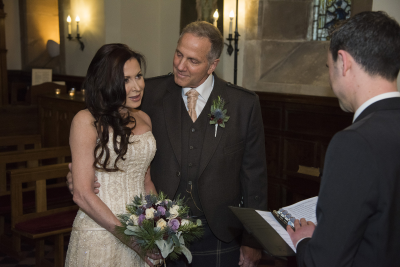 Rhea and Gerry saying Vows with Rev Gooding
