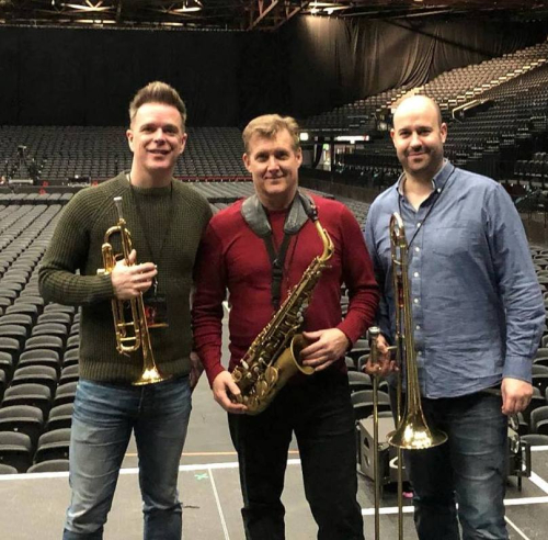Rick Keller and horn players at The Genting Arena