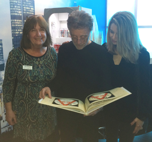 Frankie looking at book with Lynn and Jackie
