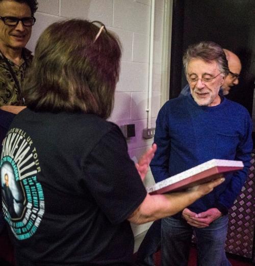 Lynn presenting Frankie with book at MEN December 2018